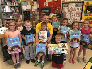 Dr. Maier visited classrooms to distribute books to students to build their home libraries.
