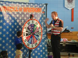 Student Shown Spinning the Wheel of Wisdom